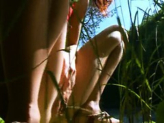 petite-russian-girl-peeing-in-a-forest