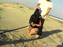 jap-school-babe-held-as-sex-slave-pissing-on-the-beach