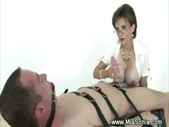 domina-ruling-over-a-dick-as-she-is-about-to-cbt