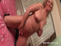 Horny mature in boots vibrating her pink cunt